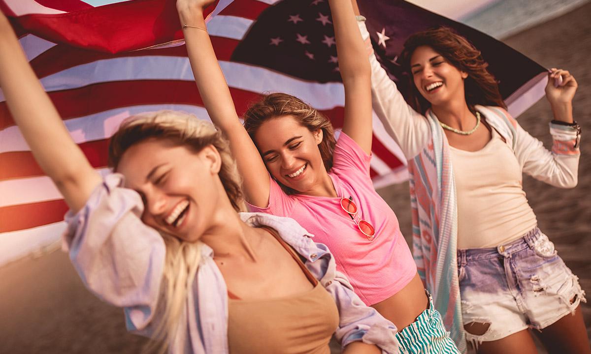 girls holding a usa flag