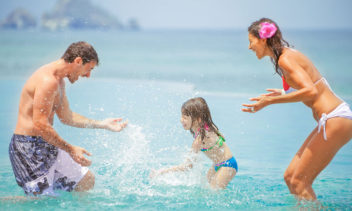 family at the garza blanca pool